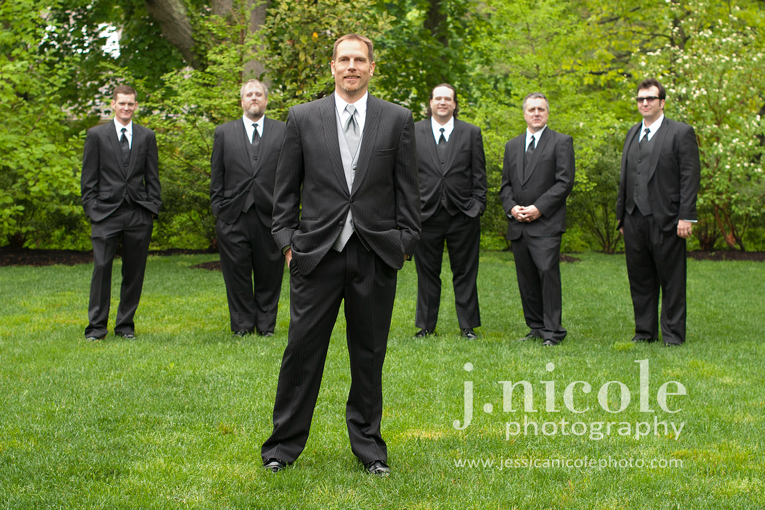 All the groomsmen and the groom front and center.