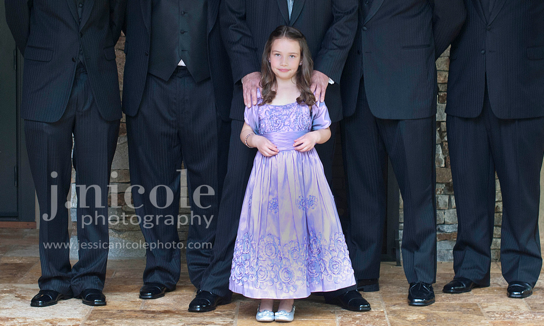 The sweet flower girl with the groomsmen.